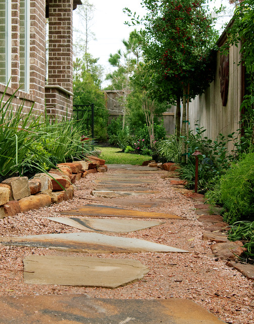 Inspiration For A Traditional Side Yard Landscaping In Houston.