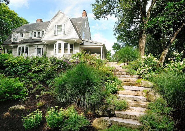 This is an example of a large contemporary shade hillside stone landscaping in Boston for summer.