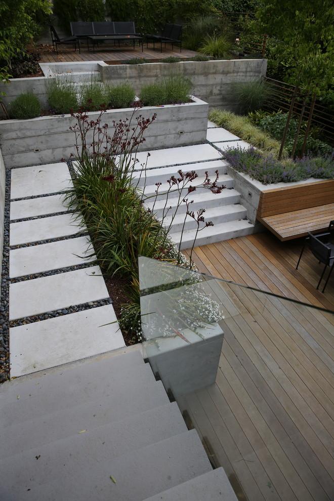 Design ideas for a small modern partial sun backyard landscaping in San Francisco.
