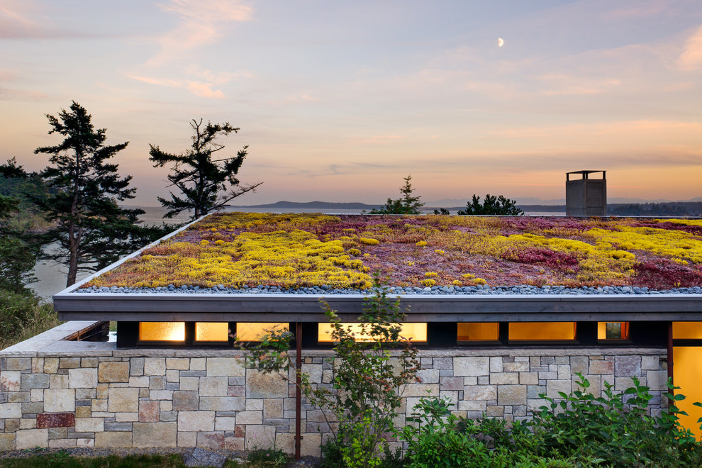 This is an example of a mid-sized beach style full sun rooftop gravel landscaping in Seattle.