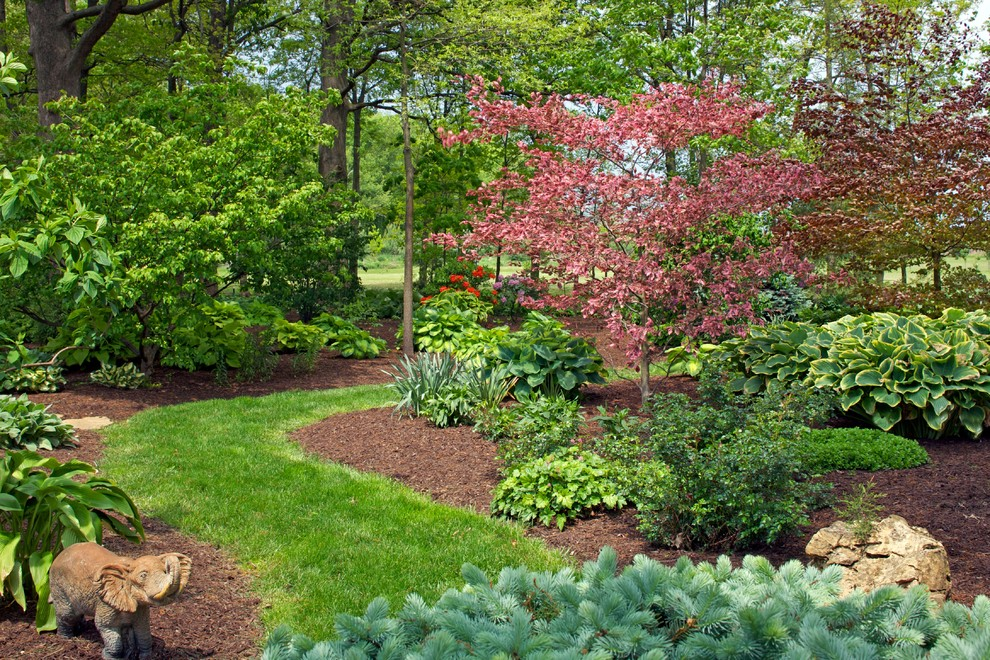 Photo of a large contemporary shade backyard garden path in Chicago for summer.