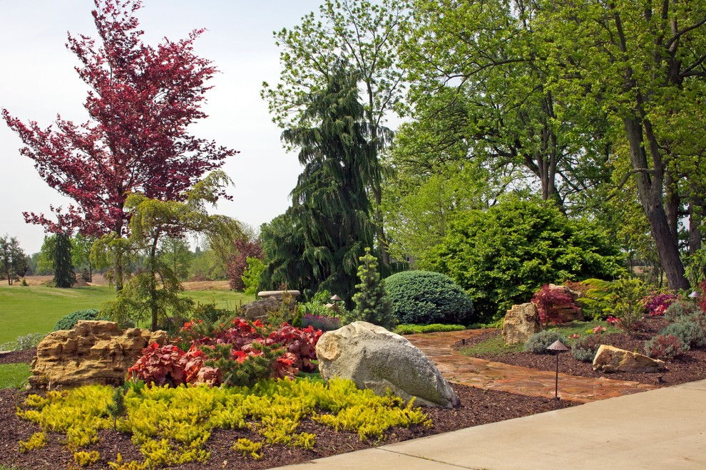 This is an example of a large contemporary partial sun side yard stone garden path in Chicago for summer.