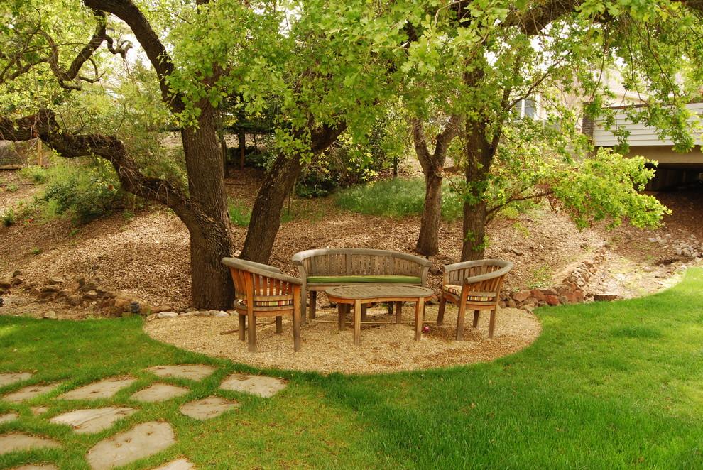 Photo of a contemporary backyard gravel landscaping in San Francisco.