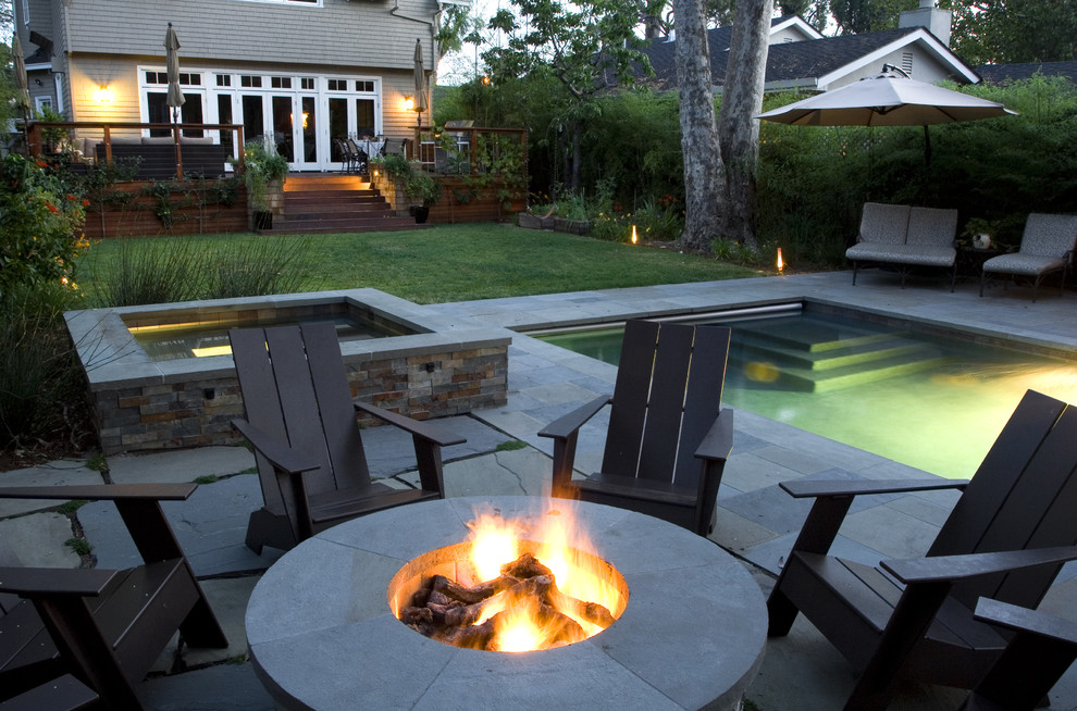 Photo of a contemporary backyard landscaping in San Francisco with a fire pit.