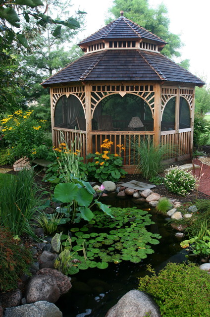 Outdoor Living with Water Gardens tropical garage and shed