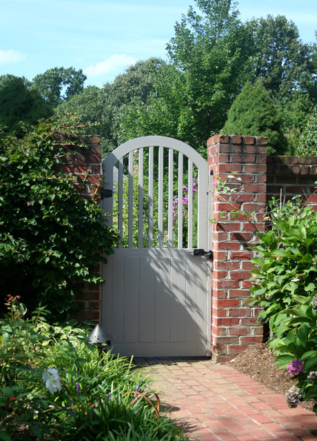 Painted wood garden gate with brick wall traditional for Wood garden gate designs