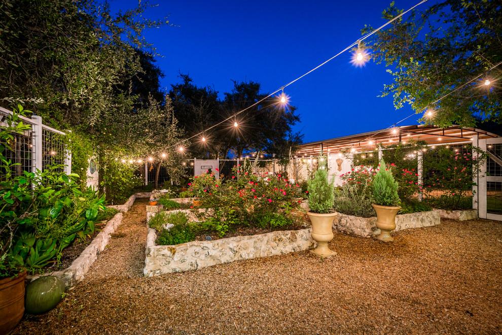 Inspiration for a large farmhouse full sun backyard mulch formal garden in Austin.