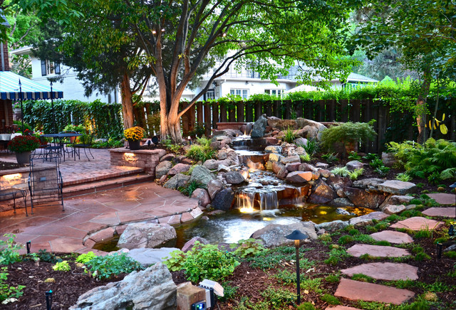Inspiration For A Traditional Backyard Stone Water Fountain Landscape In  Denver.
