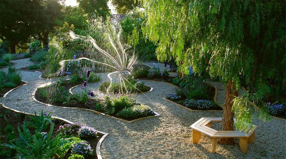 Inspiration for a large transitional partial sun backyard gravel landscaping in Santa Barbara.