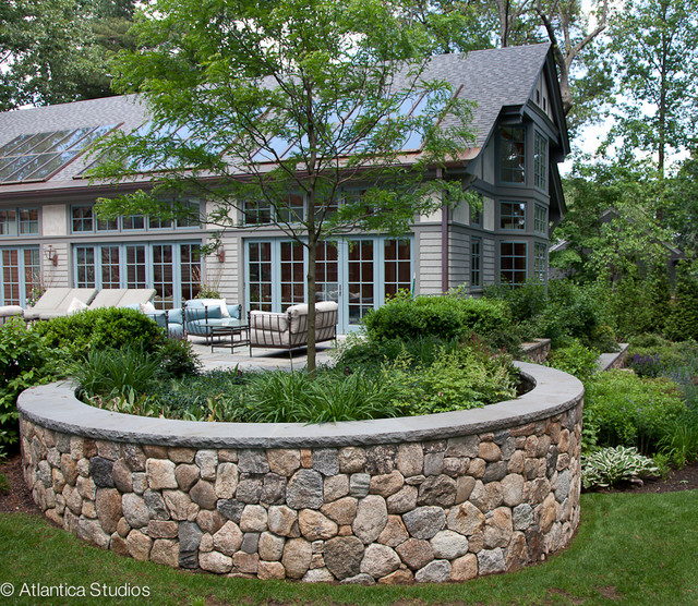 patio and curved stonewall - traditional - landscape - boston