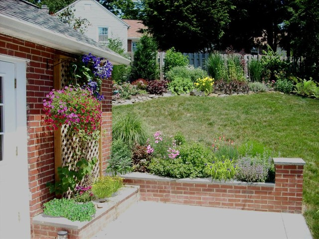 Patio With Knee Wall Perennial Garden In Devon Pa Before