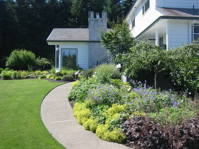 Perennial border with curved walk traditional landscape