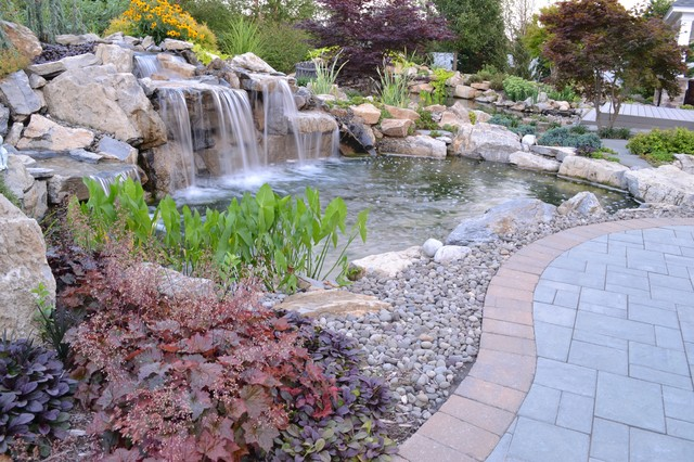 Pond and waterfall in Shoreham New York Deck and Patio Company traditional-landscape