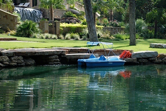 Pond With Large Ledge Stone Boat Dock Mediterranean