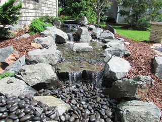 Pondless disappearing waterfalls garden detroit by for Waterscape garden designs