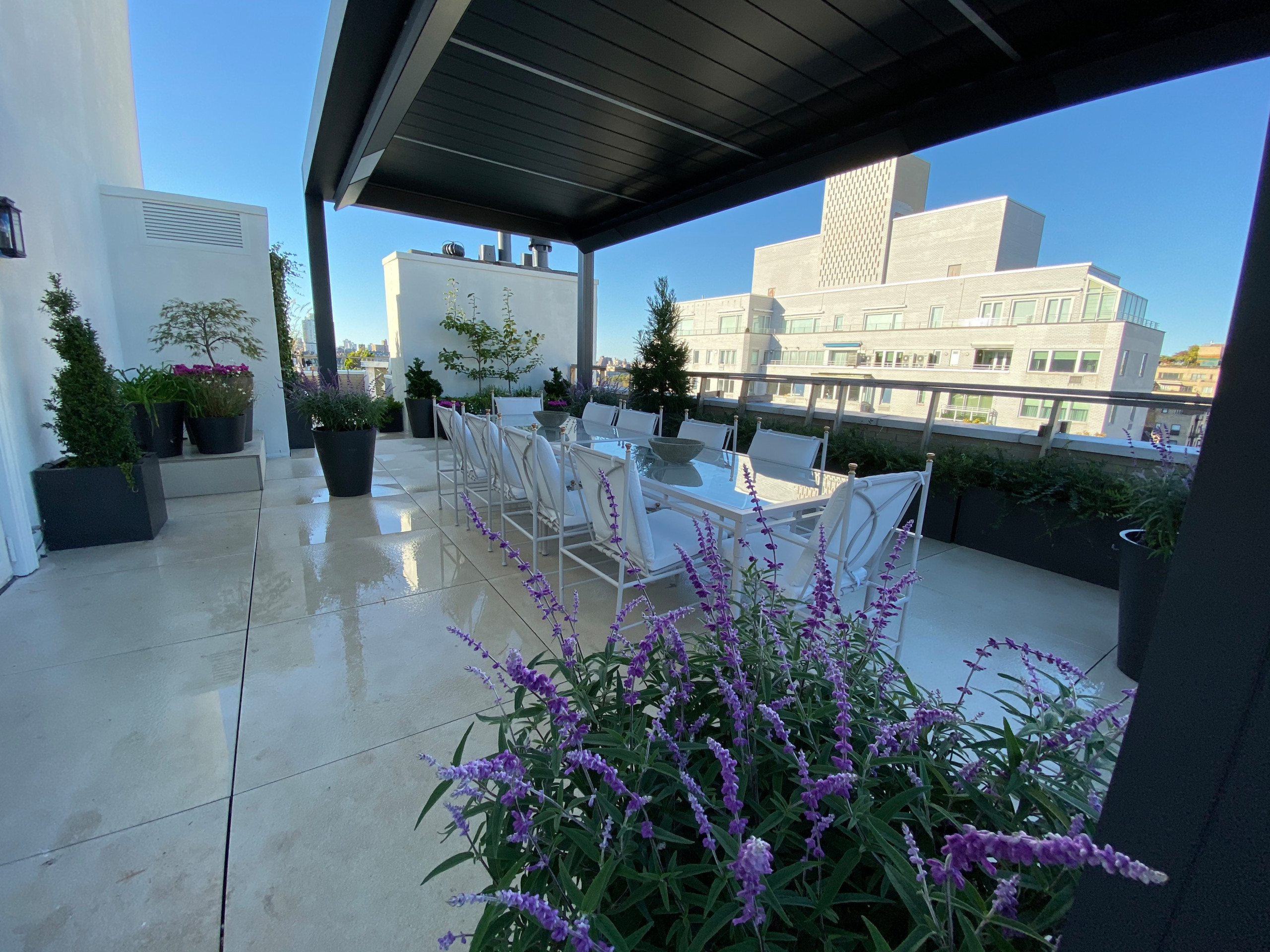 Prewar classic penthouse terrace, with a modern design intended to refresh the outdoor living space and make it more functional for the present day while providing an attractive aesthetic.