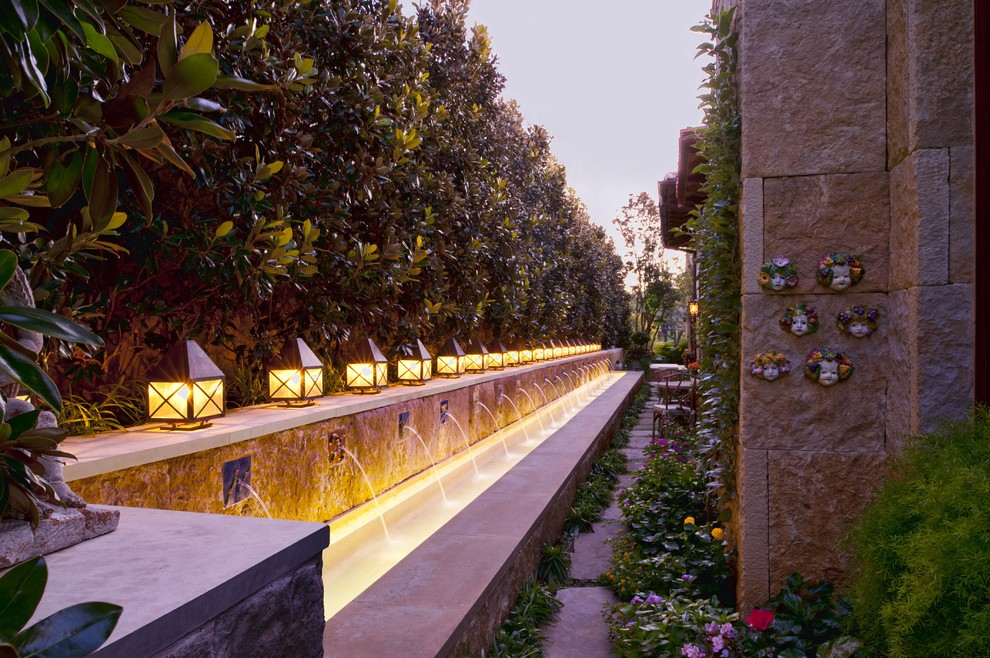 Inspiration for a mediterranean privacy side yard landscaping in Dallas.