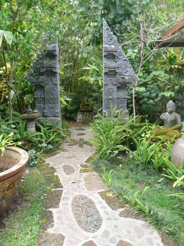 Inspiration for a tropical shade backyard landscaping in Hawaii.