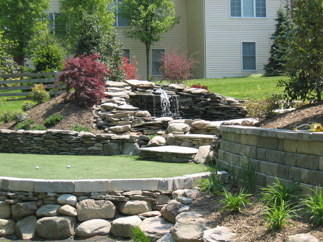 Putting Green With Retaining Wall And Waterfall Pond