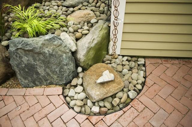 Rain chain into rain catchment pebble fountain eclectic-landscape