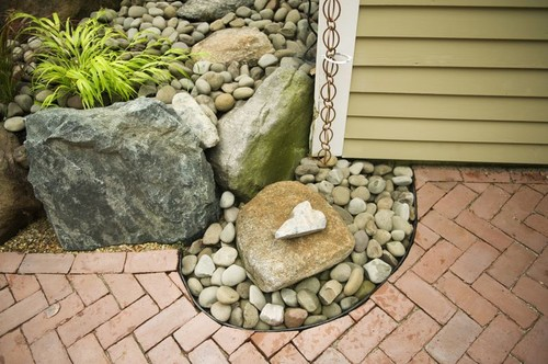 Rain Chain into rain catchment pebble fountain eclectic landscape