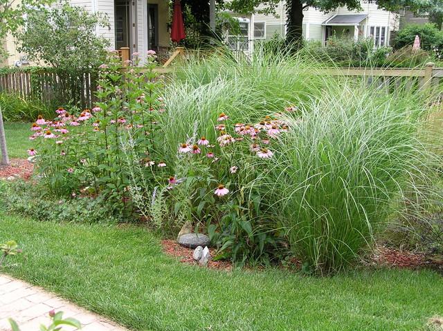 Inspiration for a contemporary back formal partial sun garden in Chicago with a garden path and brick paving.