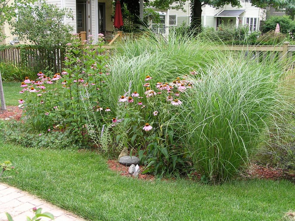 Inspiration for a contemporary partial sun backyard brick landscaping in Chicago.
