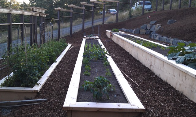 how to build a raised garden bed on a slope