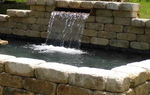 Raised formal pond traditional landscape orlando for Raised koi pond design