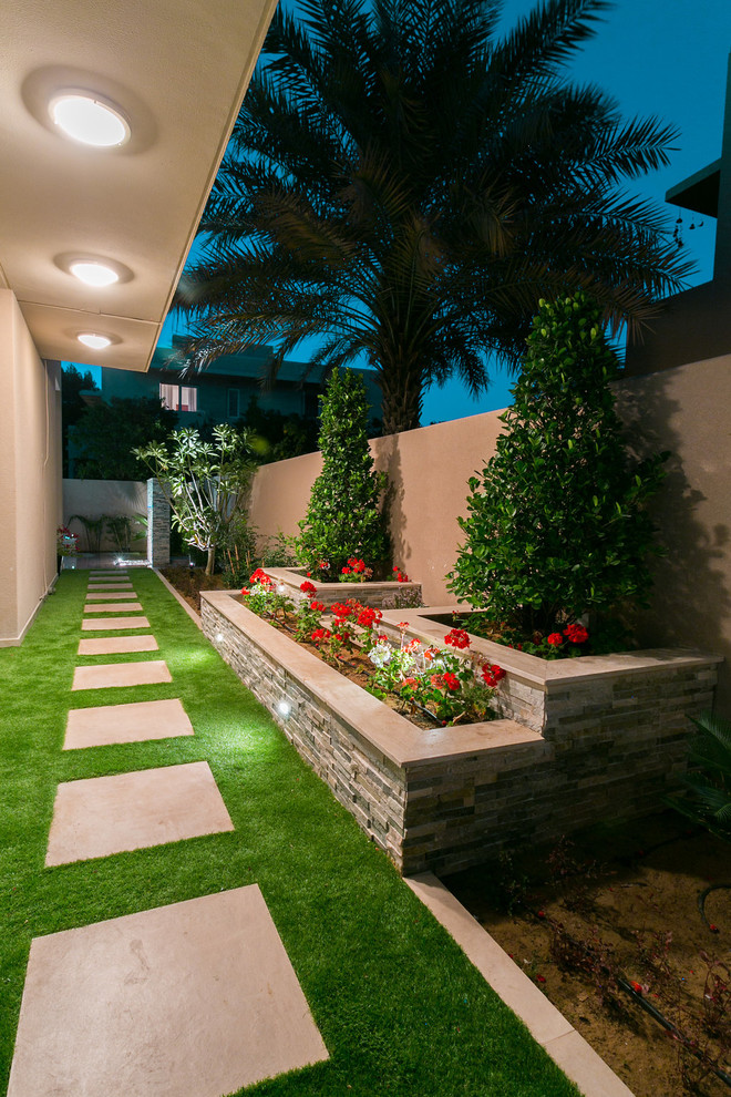Inspiration for a small contemporary side yard concrete paver landscaping in Other.