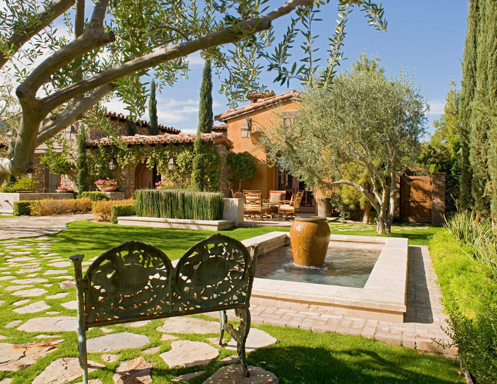 Inspiration for a mediterranean water fountain landscape in Orange County.