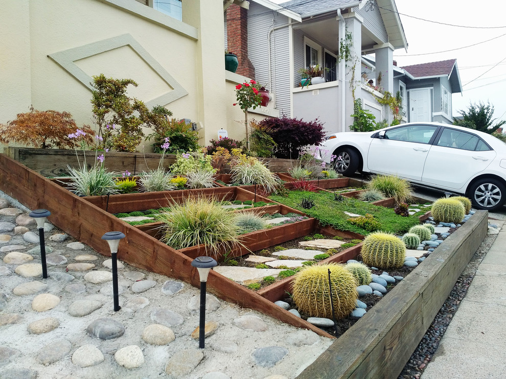 This is an example of a small contemporary partial sun front yard concrete paver formal garden in San Francisco for summer.