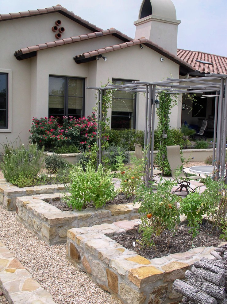 Inspiration for a mediterranean vegetable garden landscape in Austin.