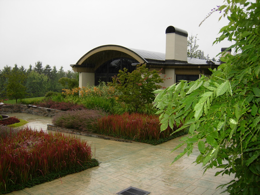 This is an example of a contemporary backyard stone landscaping in Seattle.