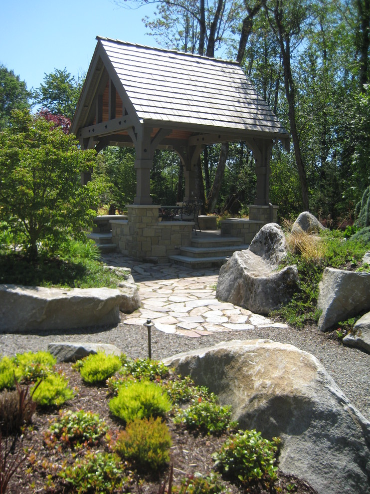 Photo of a traditional backyard stone landscaping in Burlington.