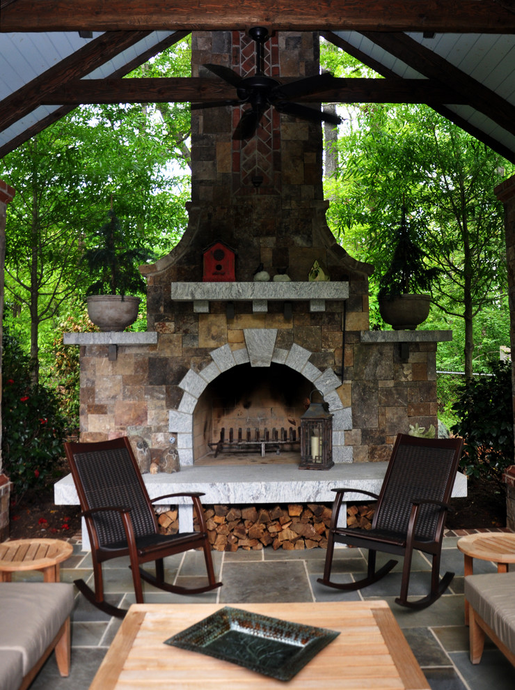 This is an example of a large traditional shade backyard brick landscaping in Other with a fire pit.