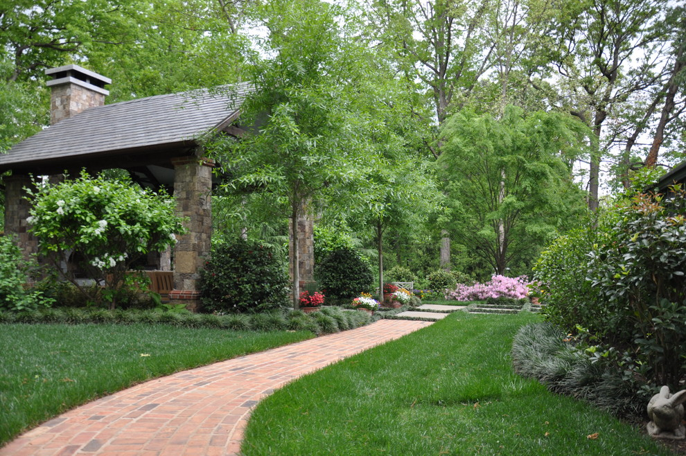 Photo of a large traditional shade backyard brick garden path in Other.