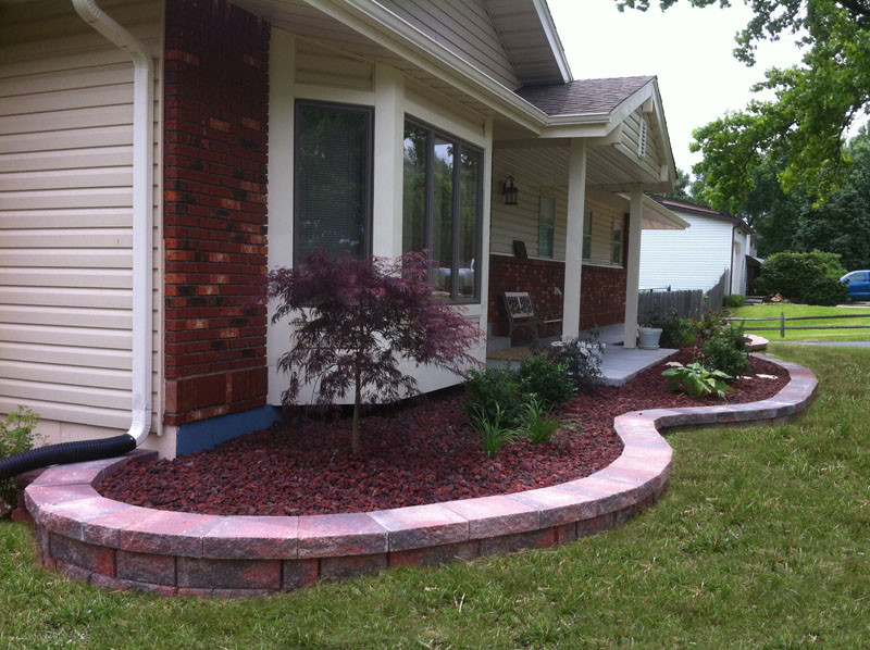 Design ideas for a small traditional partial sun front yard retaining wall landscape in St Louis.