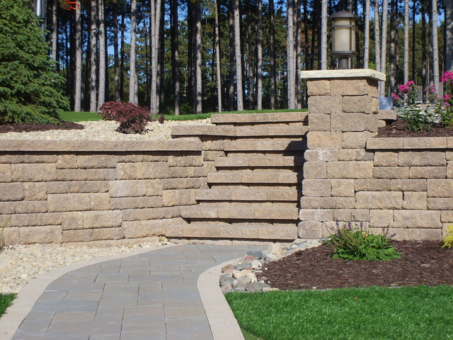 Retaining wall with built in lighting and stairs traditional landscape