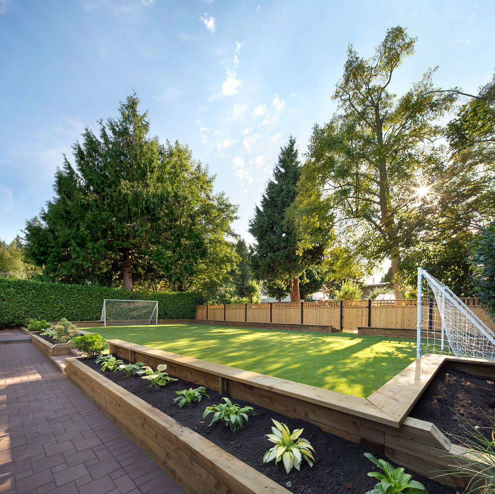 This is an example of a transitional partial sun backyard brick outdoor sport court in Vancouver.