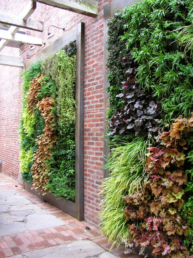 brick wall with inset wooden planters going vertically
