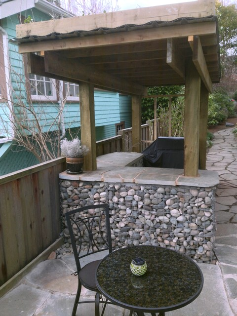 Rock gabion outdoor bar with green roof rustic for Landscaping rocks vancouver