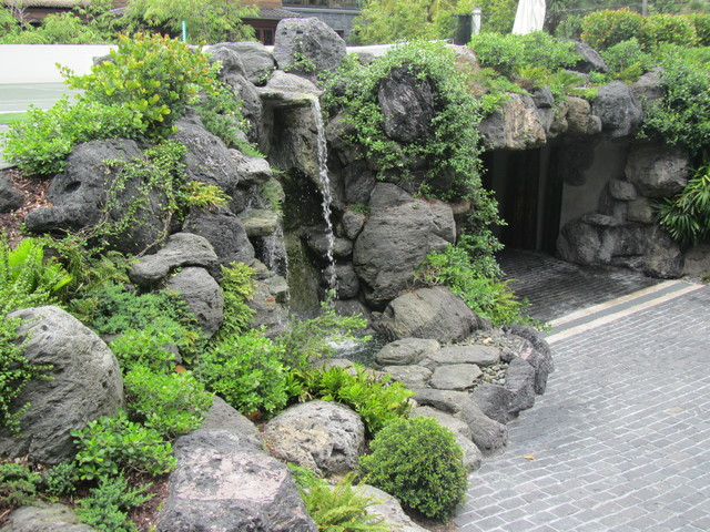 Rock waterfall and pond asian landscape miami by for Japanese water feature for sale