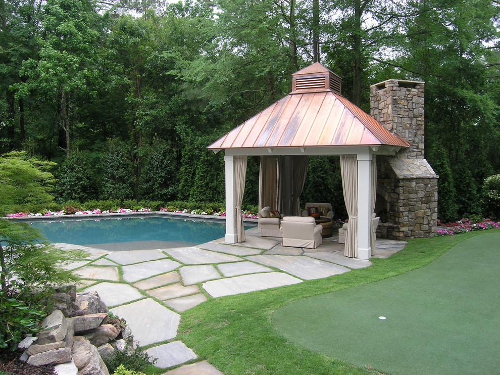 Photo of a traditional landscaping in Atlanta with a fire pit.