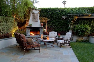 Small outdoor fireplace integrated into planter hardscape.