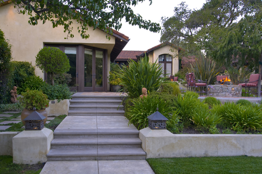 This is an example of a mediterranean hillside landscaping in San Francisco with a fire pit.