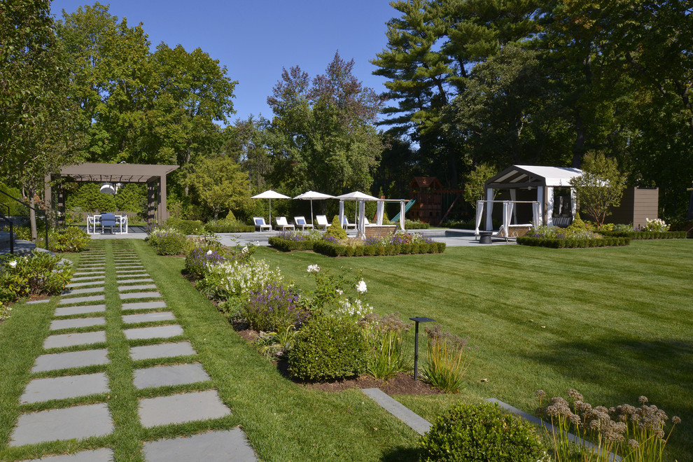 Inspiration for a huge traditional full sun backyard concrete paver garden path in New York.