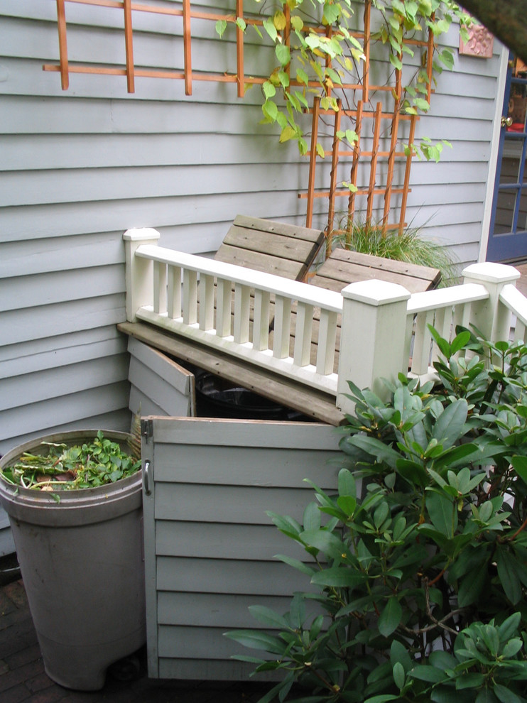 Design ideas for a small eclectic shade backyard landscaping in Seattle with decking for summer.