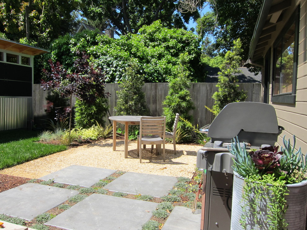 This is an example of a small contemporary drought-tolerant and partial sun backyard concrete paver landscaping in San Francisco.