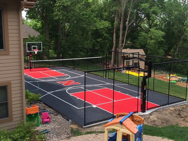 Snapsports backyard multi game court 39 huskers 39 theme for Backyard sport court